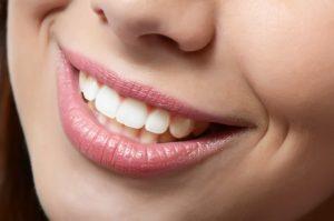 нарастить зуб сумы